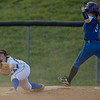 Kirsten Fletcher streaches out for the play as Brianna Allen charges towards first base