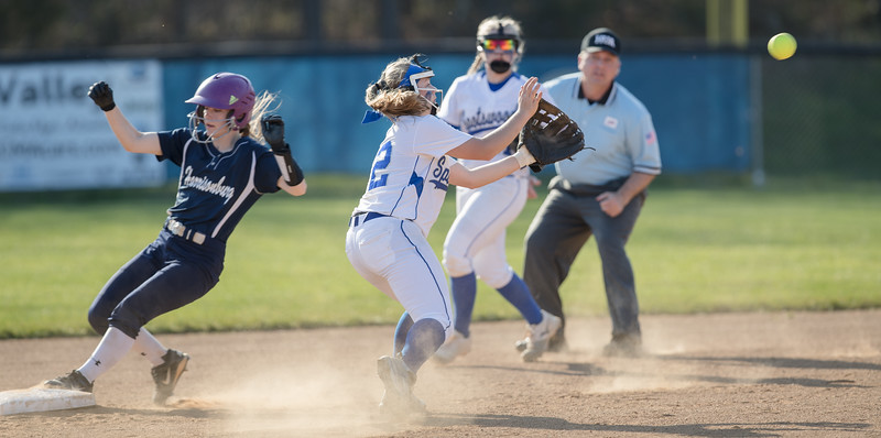 A Harrisonburg player beats the play to second base.