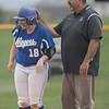 Haileigh Lutz is congratulated by Coach Lewellen after a base hit