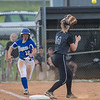 Bethany Martz attempts to beat the play to first base