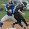 Emerson Adkins and Anna Phillips collide at first base