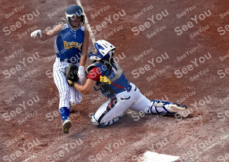 -Messenger photo by Britt Kudla<br /> Carlie Thompson of Humboldt attempts to slide around Albia Alex Beard during class 3A consolation on Friday