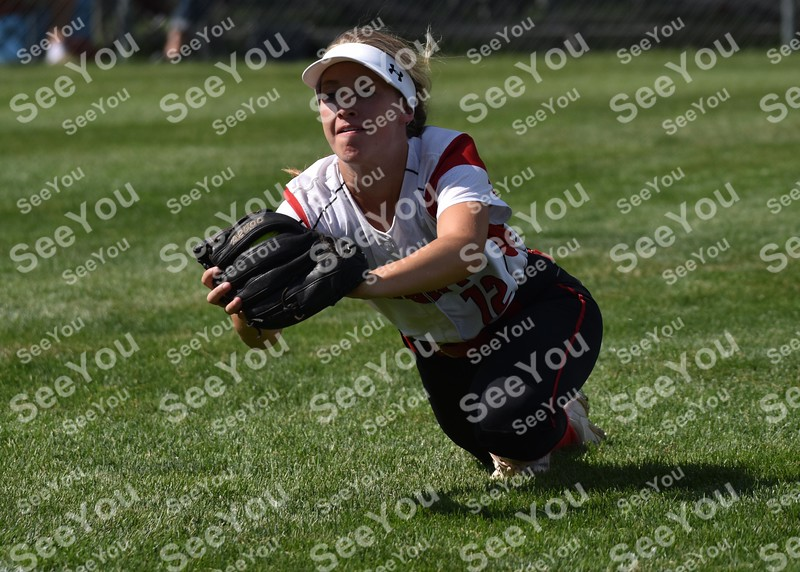 -Messenger photo by Britt Kudla<br /> Emma Johnson of Davenport Assumpion catches a fly ball against Roland-Story during class 3A championship on Friday