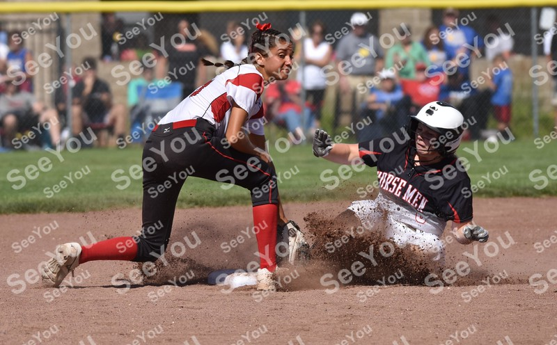 -Messenger photo by Britt Kudla <br /> Davenport Asuumpion Nicole Yoder attempts to tag Jessica Hovick during class 3A championship on Friday