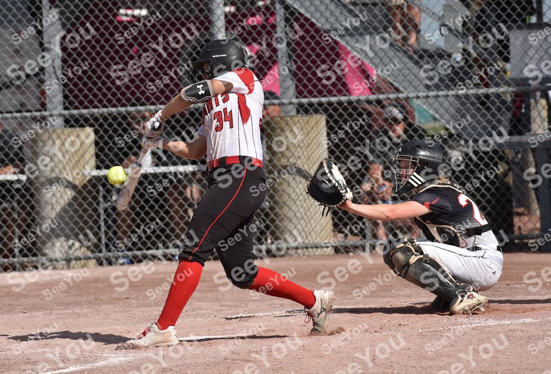 -Messenger photo by Britt Kudla<br /> Carlie Sammon of Davenport Assumpion connects for a single against Roland-Story during class 3A championship on Friday