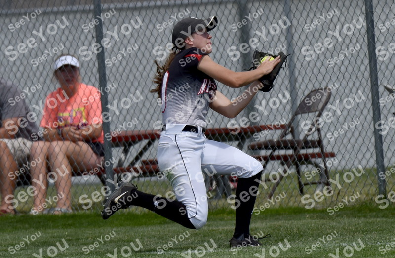 -Messenger photo by Britt Kudla<br /> Juliann Clark of Roland-Story catches a fly ball against Albia during class 3A semi-finals on Wednesday