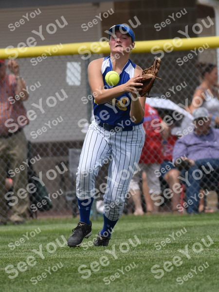 -Messenger photo by Britt Kudla<br /> Rachel Darling of Humboldt attempts to catch a fly ball against Davenport Assumpions during class 3A semi-finals on Wednesday