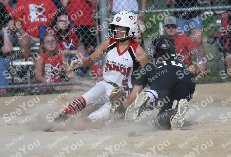 -Messenger photo by Britt Kudla<br /> Aubrey Davis of Fort Dodge slide around Dubuque Kayla LaPage during class 5A consolation on Wednesday