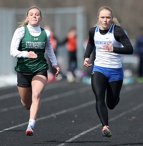 Brunswick's Maddy Neitzel runs ahead of Strongsville's Karson Cobb to win the 100 meter dash at the Strongsville Elite meet. AARON JOSEFCZYK / GAZETTE