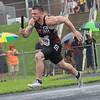 Chandler Breeden runs the first leg of the boys 4x100 relay