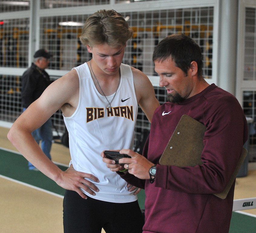Bud Denega | The Sheridan Press<br /> Big Horn's Kade VanDyken goes over film with head coach Kirk McLaughlin during the state track and field meet at Kelly Walsh High School Saturday, May, 19, 2018.