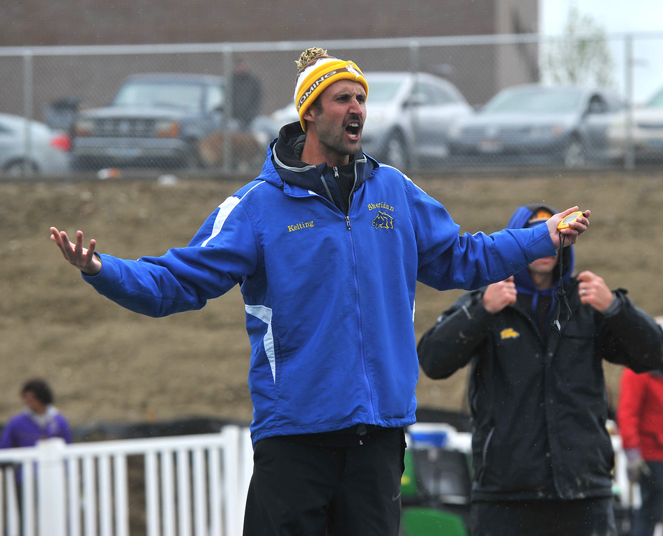 Bud Denega | The Sheridan Press<br /> Sheridan track and field head coach Taylor Kelting yells at his runners during the 1,600-meter run during the state track and field meet at Kelly Walsh High School Saturday, May, 19, 2018.