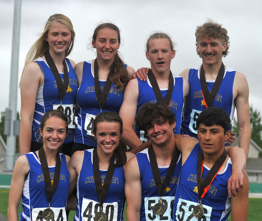 Bud Denega | The Sheridan Press<br /> Sheridan's 1,600-meter relay teams smile after winning their respective races during the state track and field meet at Kelly Walsh High School Saturday, May, 19, 2018.