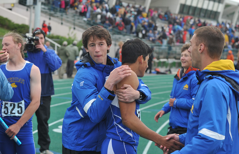 Bud Denega | The Sheridan Press<br /> Sheridan's Alex Garber, left, celebrates with Matt Roma following the 1,600-meter relay at the state track and field meet at Kelly Walsh High School Saturday, May, 19, 2018.