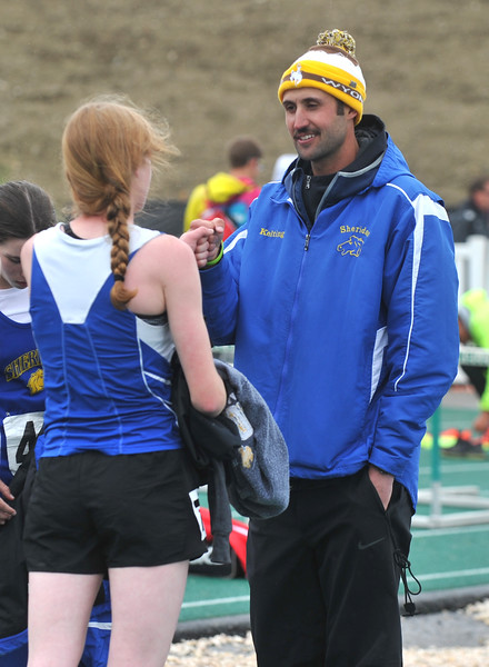 Bud Denega | The Sheridan Press<br /> Sheridan track and field head coach Taylor Kelting congratulates Trinity Preston following the 1,600-meter run during the state track and field meet at Kelly Walsh High School Saturday, May, 19, 2018.