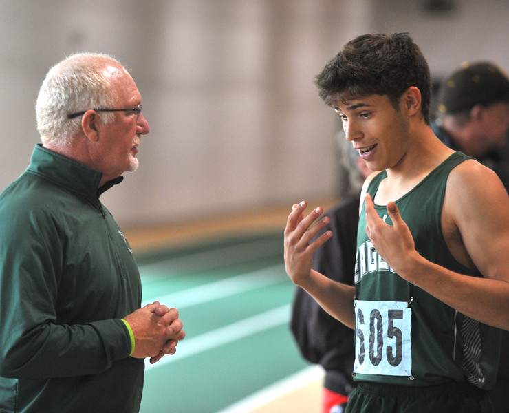 Bud Denega | The Sheridan Press<br /> Tongue River's Cooper Vollmer talks with one of his assistant coaches during the high jump at the state track and field meet at Kelly Walsh High School Saturday, May, 19, 2018.
