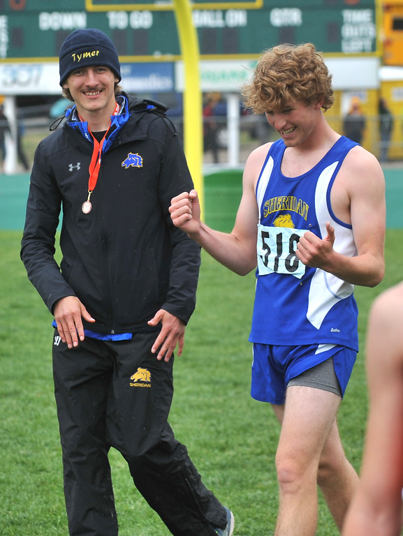 Bud Denega | The Sheridan Press<br /> Sheridan's Tymer Goss, left, and Brian Gonda celebrate after the 1,600-meter run during the state track and field meet at Kelly Walsh High School Saturday, May, 19, 2018.