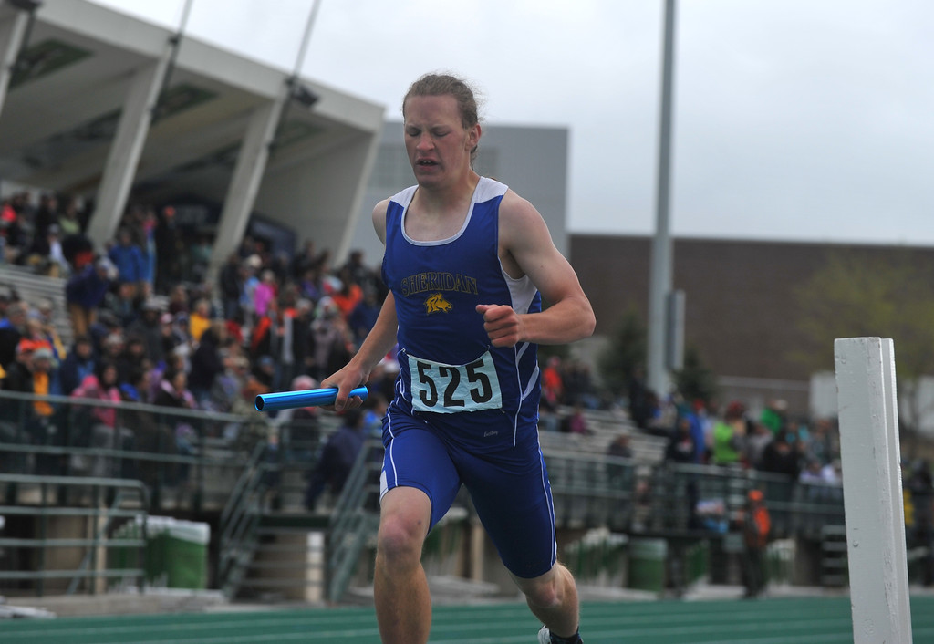 Bud Denega | The Sheridan Press<br /> Sheridan's Alec Riegert crosses the finish line in the 1,600-meter relay during the state track and field meet at Kelly Walsh High School Saturday, May, 19, 2018.