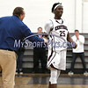 2/6/2018 Mike Orazzi | Staff<br /> Bristol Central's Tim Barrette congratulates Jaekwon Spencer (25) after he surpassed 1000 points during Tuesday night's boys basketball game with Hall at BC.