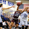 1/18/2018 Mike Orazzi   Staff<br /> Bristol Central's Ideara Gordon (21) and  Bristol Eastern's Paige McLaughlin (2) and Avery Arbuckle (42) during the girls basketball game at BEHS Thursday night.