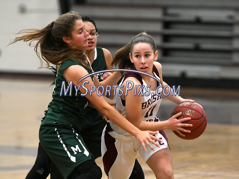 1/16/2018 Mike Orazzi   Staff<br /> Bristol Central Girls Basketball's Ashley Macdonald (11) and Maloney's Alexa Papallo (15) and Dasia White (21) during Tuesday night's game in Bristol.