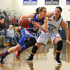 1/20/2018 Mike Orazzi | Staff<br /> Plainville's Caitlin Barker (3) and Bristol Eastern's Avery Arbuckle (42) during Saturday's girls basketball game with Bristol Eastern in Bristol.