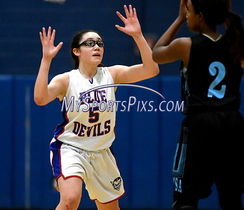 12/28/2017 Mike Orazzi   Staff Plainville's Jaida Vasquez (5) and SMSA's Kalissa Jameson (22) during the Rybczyk Memorial Holiday Basketball Tournament at Plainville High School Thursday afternoon.