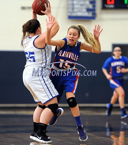 1/20/2018 Mike Orazzi | Staff Plainville's Olivia Wazorko (15) and Bristol Eastern's Cassie Doyon (35) during Saturday's girls basketball game with Bristol Eastern in Bristol.