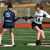 4/11/2018 Mike Orazzi | Staff<br /> East Catholic's Olivia Parizeau (15) and Bristol Co-op lacrosse's Ashley Watson (14) at Bristol Central Wednesday.