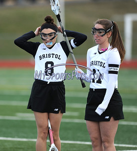 4/11/2018 Mike Orazzi   Staff Bristol Co-op lacrosse's Gabby Abramczyk (8) and Ashley MacDonald (11) at Bristol Central Wednesday.