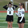 4/11/2018 Mike Orazzi   Staff<br /> Bristol Co-op lacrosse's Gabby Abramczyk (8) and Ashley MacDonald (11) at Bristol Central Wednesday.