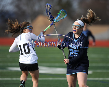 4/11/2018 Mike Orazzi   Staff Bristol Co-op lacrosse's Lily Hansen (10)  and East Catholic's Lily Ryan (25) at Bristol Central Wednesday.