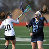 4/11/2018 Mike Orazzi | Staff<br /> Bristol Co-op lacrosse's Lily Hansen (10)  and East Catholic's Lily Ryan (25) at Bristol Central Wednesday.