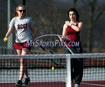 4/12/2018 Mike Orazzi   Staff Bristol Central's Michelle Helming and Erica O'Connor during Thursday's tennis match.