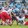 Daniel Cubbage muscles his way up the field as the Eagles defense latches on