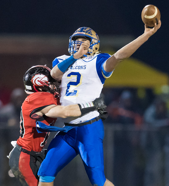 Chandler Breeden gets on on Central's Quarterback Zebadiah Dyer