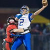 Chandler Breeden gets on on Central's Quarterback Zebadiah Dyer