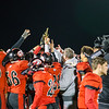 The Eagles hoist the Region Championship Trophy