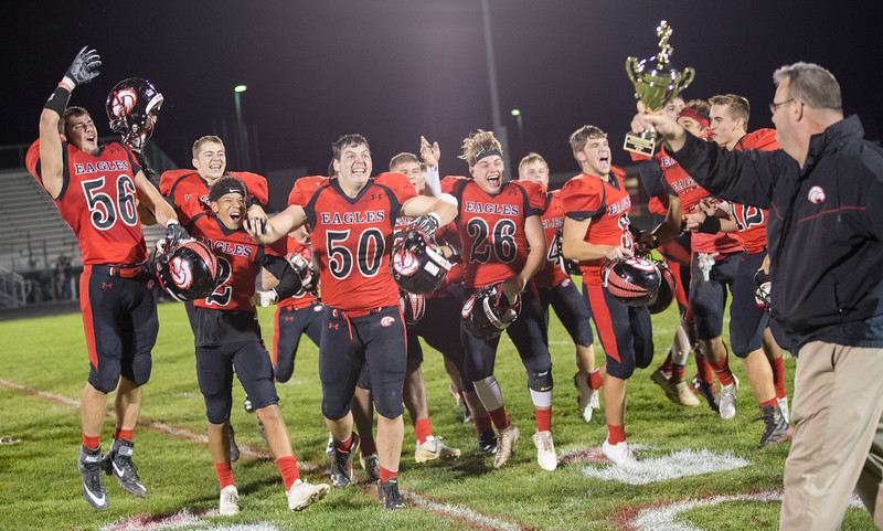 The Eagles celebrate the undefeated season and winning the Shenandoah District Trophy