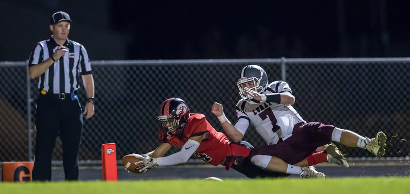 Darrias Brown streaches trying to get the ball in to the endzone as Luray's Dalton Griffith knocks him down on the sideline