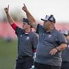 Coach Colman signals to his offense