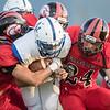 Madison's Quarterback Elijah Lewis finds himself surrounded by Eagles