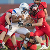 Madison's Quarterback Elijah Lewis finds himself surrounded once more by Eagles