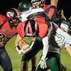 Darrias Brown flips over a Wilson defender