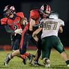 Jaeden Rouse moves the ball as his teammate provides the block