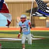 Lumberton Raider Weston Tinsley, 25, carries the flag on to the field at Raider Stadium. Photo by Drew Loker
