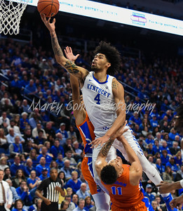 Florida's Keyontae Johnson draws the charge from Kentucky's Nick Richards on Saturday.  MARTY CONLEY/ FOR THE DAILY INDEPENDENT