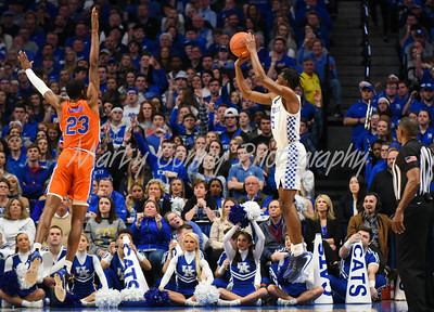 Immanuel Quickley of Kentucky shoots a three point shot as Florida's Scottie Lewis pressures on Saturday.  MARTY CONLEY/ FOR THE DAILY INDEPENDENT