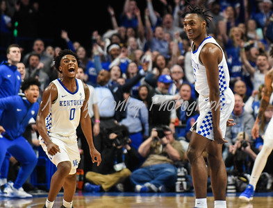Kentucky's Immanuel Quickley and Ashton Hagans celebrate after a Kentucky score against Florida on Saturday.  MARTY CONLEY/ FOR THE DAILY INDEPENDENT
