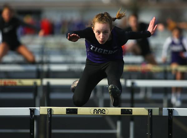 4-2-19<br /> Northwestern-Western track and field<br /> NW's Makala Pfefferkorn in the 100 m hurdles.<br /> Kelly Lafferty Gerber   Kokomo Tribune